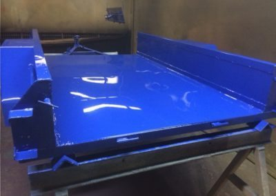 Trailer after sandblasting with primer and top coat applied